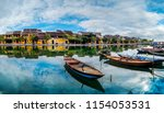 view of busy river in hoi an ... | Shutterstock . vector #1154053531