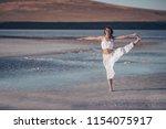beautiful woman doing yoga at... | Shutterstock . vector #1154075917