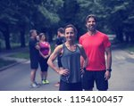 portrait of a healthy jogging... | Shutterstock . vector #1154100457