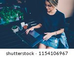 skilled young female software... | Shutterstock . vector #1154106967