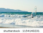 windsurfers in the sea on crete ... | Shutterstock . vector #1154140231
