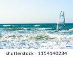 windsurfers in the sea on crete ... | Shutterstock . vector #1154140234