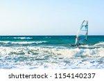 windsurfers in the sea on crete ... | Shutterstock . vector #1154140237