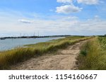 country walk besides the sea... | Shutterstock . vector #1154160667