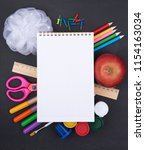 school supplies on blackboard  | Shutterstock . vector #1154163034