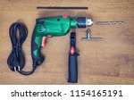perforator with its work kit | Shutterstock . vector #1154165191