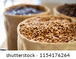 coffee beans in canvas bag | Shutterstock . vector #1154176264