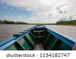 traveling by boat in tambopata... | Shutterstock . vector #1154182747