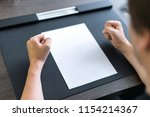 businessman sitting at table.... | Shutterstock . vector #1154214367