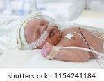 Small photo of premature baby in incubator