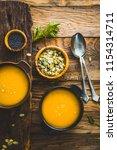 pumpkin soup. autumn dinner... | Shutterstock . vector #1154314711