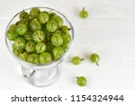 green delicious gooseberry on... | Shutterstock . vector #1154324944