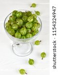 green delicious gooseberry on... | Shutterstock . vector #1154324947