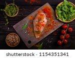 board with raw chicken fillet...   Shutterstock . vector #1154351341
