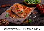 board with raw chicken fillet...   Shutterstock . vector #1154351347