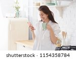 young woman using smartphone... | Shutterstock . vector #1154358784