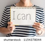 startup young woman holding... | Shutterstock . vector #1154378044