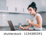 beautiful young girl checking... | Shutterstock . vector #1154385391