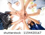 low angle view group of teenage ... | Shutterstock . vector #1154420167