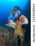a mess of discarded plastic and ... | Shutterstock . vector #1154428561