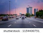 night traffic. cars on highway... | Shutterstock . vector #1154430751