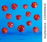 green apples floating on blue... | Shutterstock . vector #1154444614