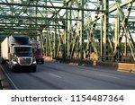 two semi trucks of different...   Shutterstock . vector #1154487364