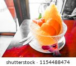 yellow ice shaved in glass bolw ... | Shutterstock . vector #1154488474