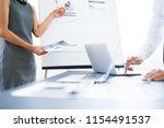 asian business adviser meeting...   Shutterstock . vector #1154491537