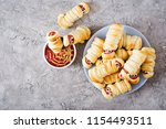 scary sausage mummies in dough... | Shutterstock . vector #1154493511