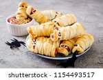 scary sausage mummies in dough... | Shutterstock . vector #1154493517