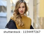 blonde woman in urban... | Shutterstock . vector #1154497267