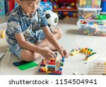 little asian boy playing with... | Shutterstock . vector #1154504941