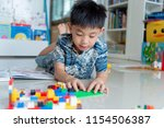 little asian boy playing with... | Shutterstock . vector #1154506387