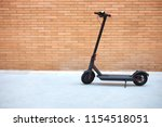 electric scooter  brick wall | Shutterstock . vector #1154518051