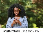disappointed african american... | Shutterstock . vector #1154542147