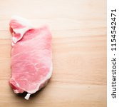 food   raw fresh pork meat on... | Shutterstock . vector #1154542471