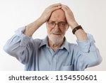 isolated studio portrait of...   Shutterstock . vector #1154550601