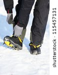 Crampons closeup. Crampons closeup. Crampon on winter boot for climbing, glacier walking or extreme hiking on ice and hard snow. - stock photo