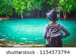 traveler woman with backpack... | Shutterstock . vector #1154573794