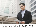 business man using tablet with... | Shutterstock . vector #1154581897