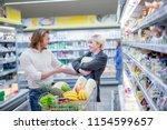consumerism concept. ordinary... | Shutterstock . vector #1154599657