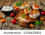 ricotta tomato basil bruschetta ... | Shutterstock . vector #1154625001