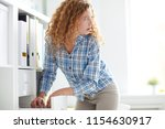 young office manager standing... | Shutterstock . vector #1154630917