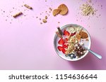 healthy smoothie in white bowl... | Shutterstock . vector #1154636644