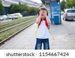 toddler boy with backpack... | Shutterstock . vector #1154667424