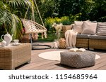 pouf on wooden terrace with... | Shutterstock . vector #1154685964