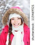 Portrait of winter woman smiling happy and cheerful outside in snow winter forest. Beautiful mixed-race Asian Chinese / Caucasian female model. - stock photo