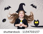 Funny Child Dressed Witch...