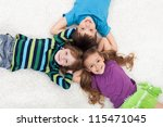 Happy kid laying on the floor - head to head - stock photo